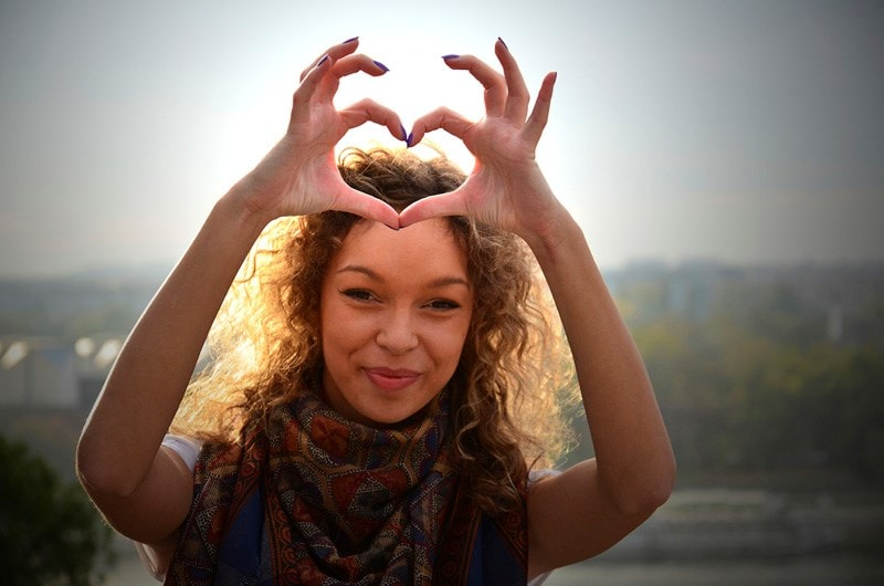 Woman making a heart shape with hands