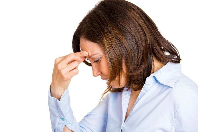 Woman pinching forehead suffering from sinus