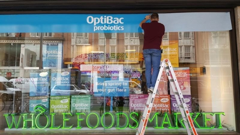 OptiBac in the window of Wholefoods