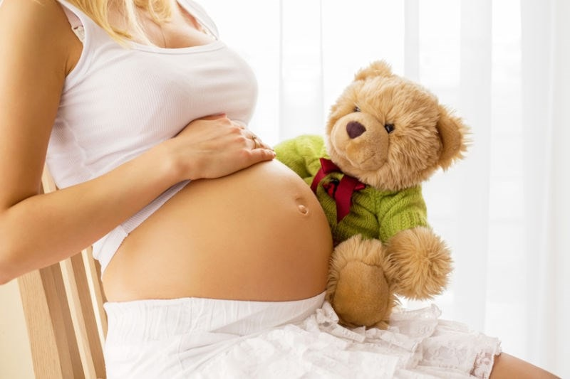 Pregnant woman with teddy
