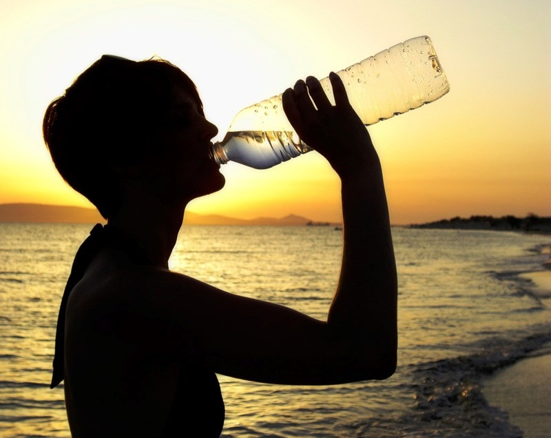 woman drinking bottled water