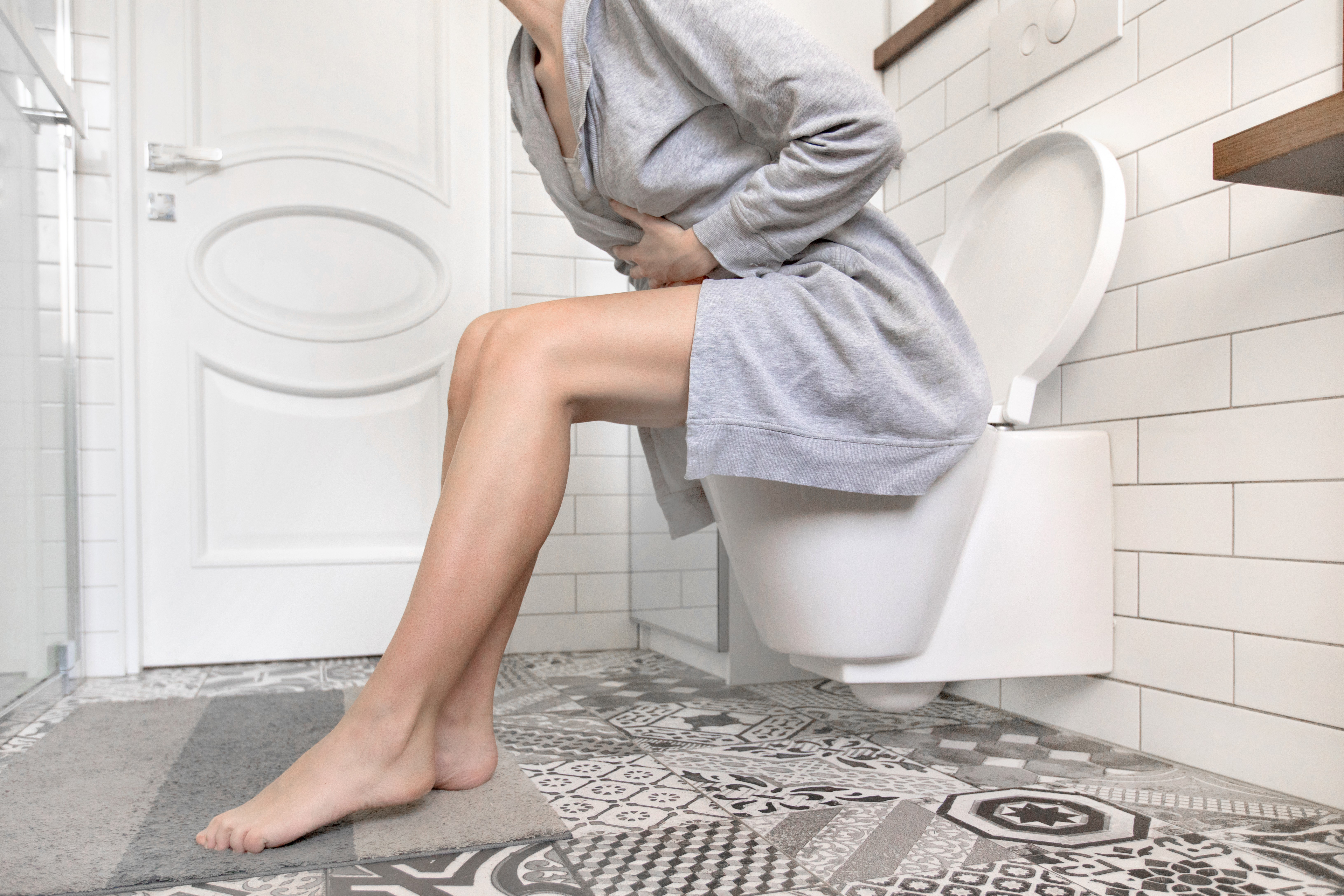 Female in pain on the toilet